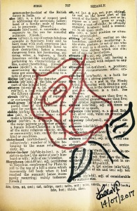 Red rose in a sire dictionary page